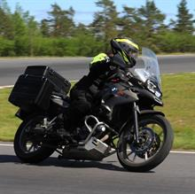 Bikerine driving and camping across the Nordics